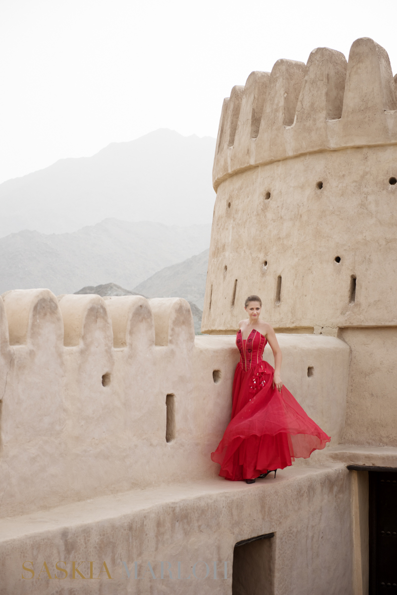 FASHION PORTRAIT RED DRESS FORT CASTLE FUJEIRAH UAE FEMALE WEDDING PHOTOGRAPHER 1