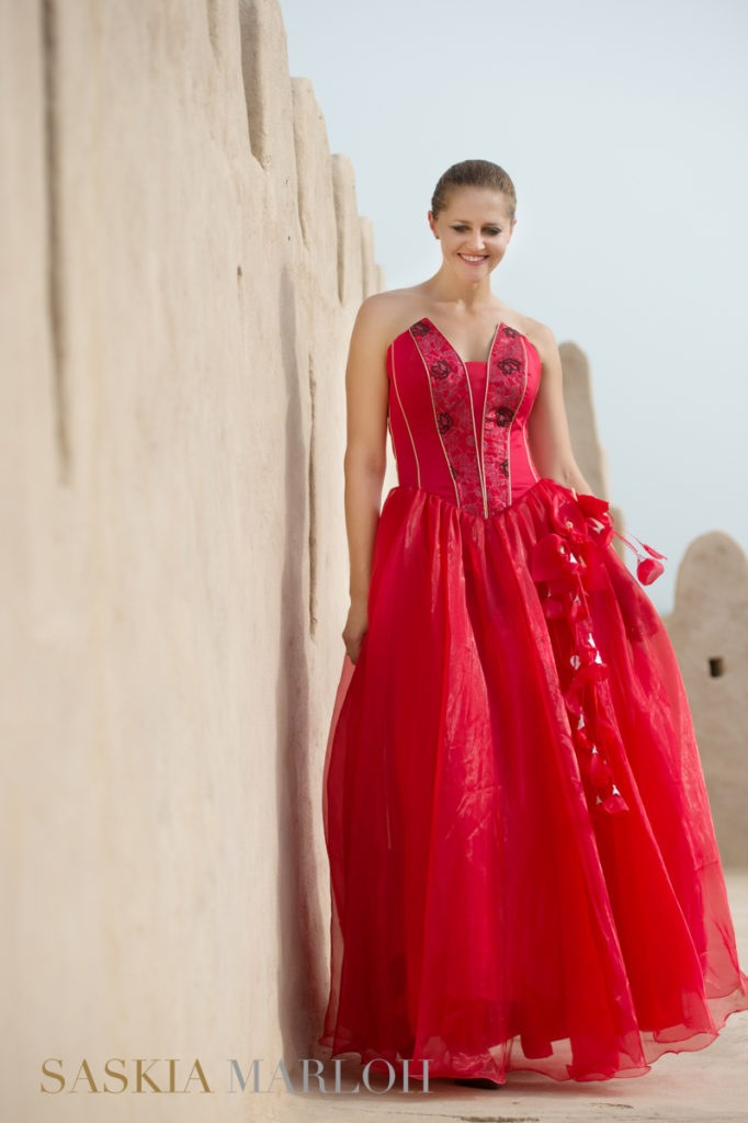 fashion-portrait-red-dress-fort-fujeirah-uae-female-wedding-photographer1